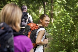 people hiking with one woman looking at viewer over her shoulder